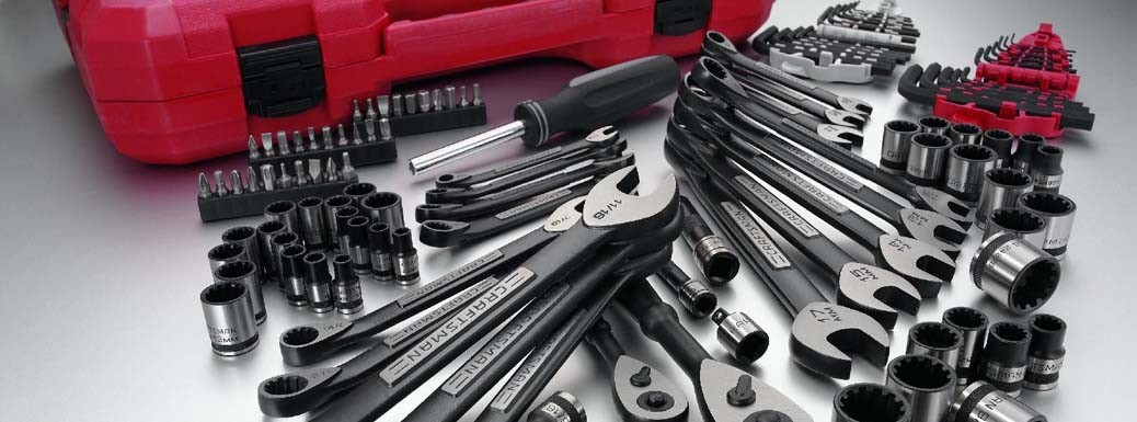 Craftsman mechanics tools on display next to a red storage case